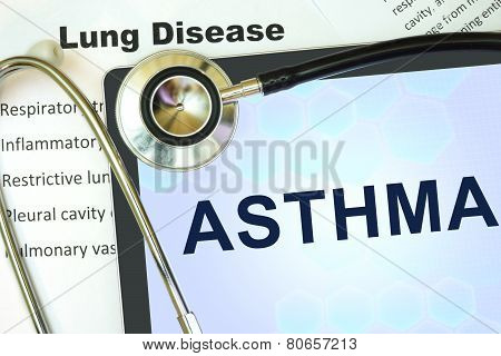 Tablet with word Asthma and stethoscope.