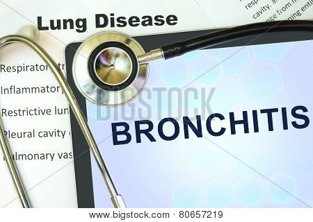 Tablet with word bronchitis and stethoscope.
