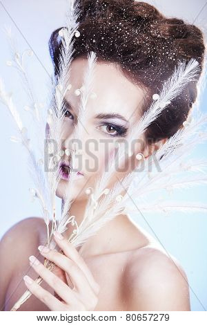 Beauty woman with smoky eyes over blue winter background. Winter beauty woman. Snow queen.