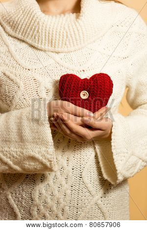 Closeup Photo Of Woman Holding Heart On Chest