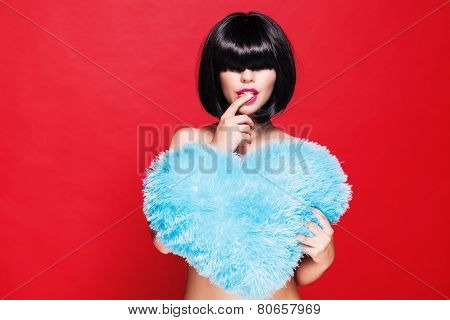Pretty attractive woman holding a blue plush heart. waiting for Valentine's Day. woman's love and fe