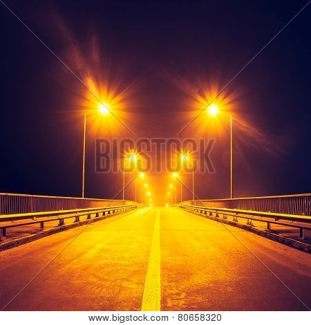 illuminated highway at night without cars Kiev Ukraine