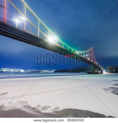 Footbridge in winter Kiev at night