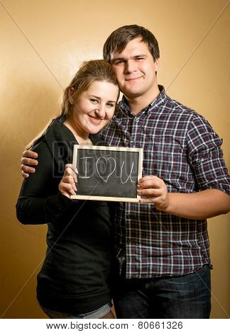 Couple In Love Holding Blackboard With