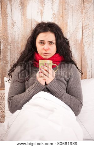 Frustrated sick girl with cup