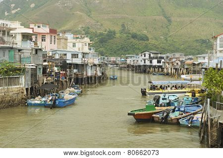 Tai O fishermen village with stilt houses and motorboats in Hong Kong, China.