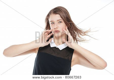 Young Beautiful Teenager Girl With Fluttering Hair Isolated
