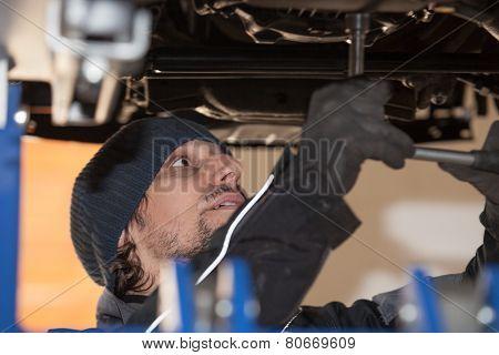 Car Mechanic Under A Car