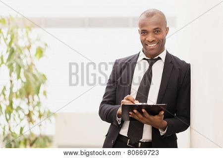 Businessman With Note Pad.