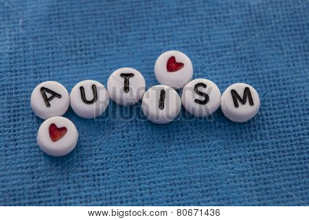 Autism spelled in craft beads