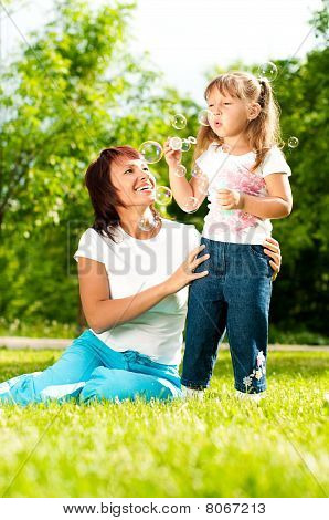 Happy Mother With Her Daughter