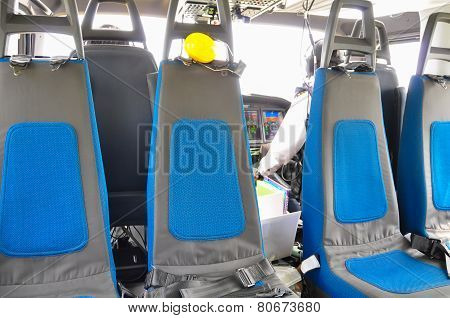 Helicopter interior and seat for passenger, seat and safety belt in interior of helicopter.