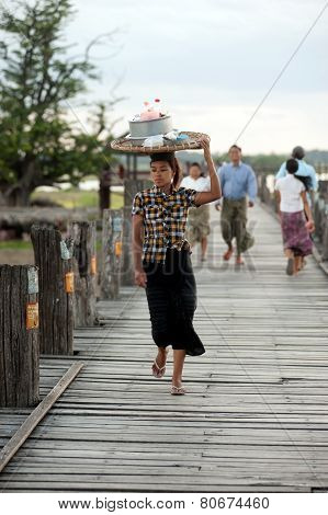 Burmese Woman Carrying On Her Head.