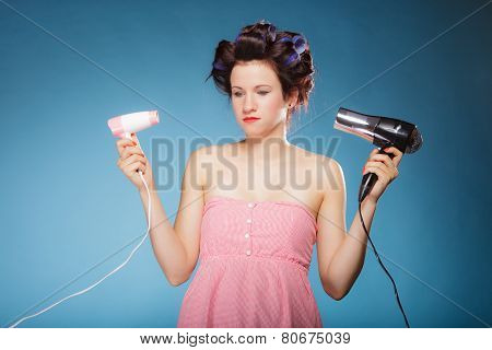 Girl With Curlers In Hair Holds Hairdryers