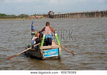 Traditional boat on the lake near U-Bein Bridge in Myanmar.