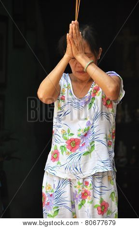 Woman Praying In Hoi An, Vietnam