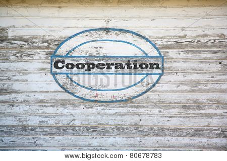Cooperation sign on shed side