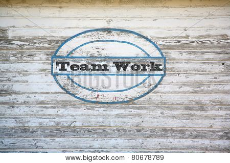 Teamwork sign on shed side