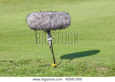 A Large Microphone Boom With Windshield Situated In Golf Tournament For Live Broadcasting.