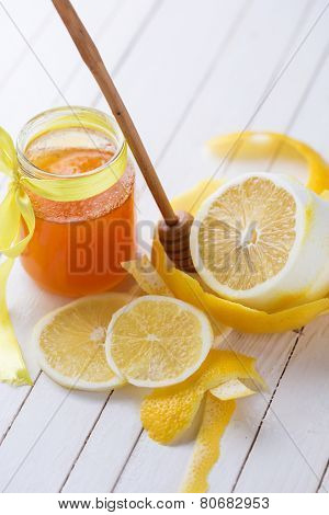 Honey In Glass Jar And Lemons