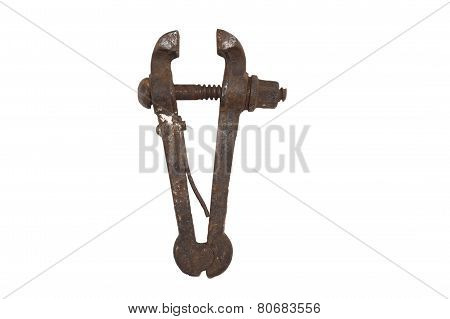 Old rusty bench vice, metal vice with a screw on a white background
