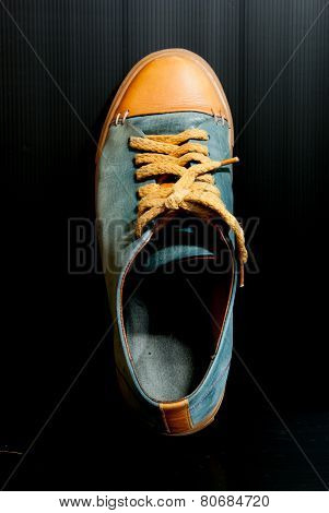 gray leather basketball shoe sneaker, isolated on black;