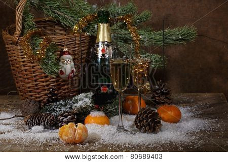 Champagne, Tangerines And Fur-tree Branch With Cones Under Snow
