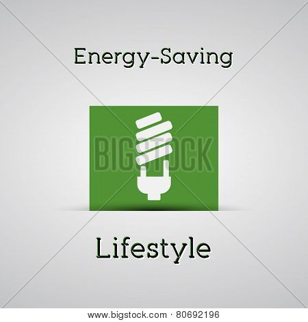 Energy Saving Lifestyle Poster. Silver Background. With Energy Saving Lamp On A Green Card. Minimali