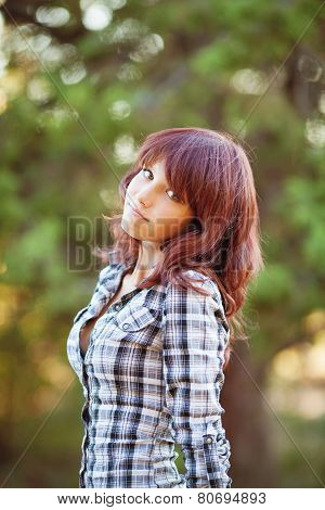Young woman walking in the park in the summer.