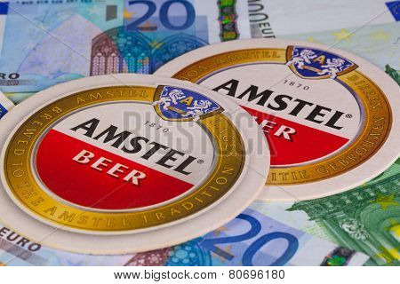 Beermats From Amstel Beer And Eur Money.