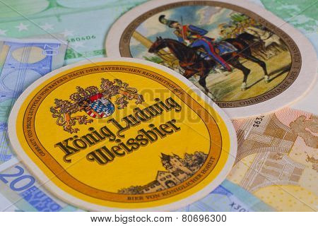 Beermats From Konig Ludwig Beer And Eur Banknotes..