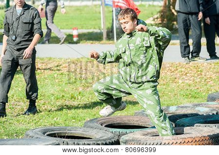 Boy participates in militarized relay