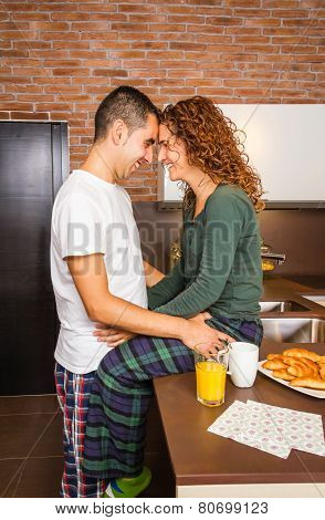 Loving couple looking at each other in a home breakfast