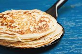 foto of traditional  - Staple of yeast pancakes traditional for Russian pancake week - JPG