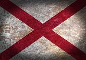 foto of alabama  - Old rusty metal sign with a flag  - JPG