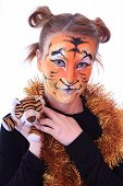 Постер, плакат: Girl in appearance a tiger with a toy tiger cub
