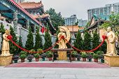 image of sinful  - golden statues at Sik Sik Yuen Wong Tai Sin Temple Kowloon in Hong Kong - JPG