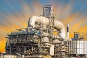 picture of machinery  - Machinery in oil refinery with sky background - JPG