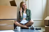 image of independent woman  - Portrait of young beautiful woman moving in new home - JPG