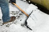 picture of snow shovel  - closw up man is snow shoveling a path - JPG