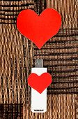 stock photo of usb flash drive  - USB Flash Drive with Heart Shape on the Fabric Background - JPG