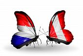 image of holland flag  - Two butterflies with flags on wings as symbol of relations Holland and Peru - JPG