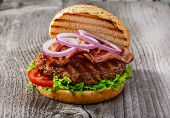 picture of hamburger  - hamburger with bacon and grilled meat on a wooden surface - JPG