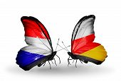 pic of holland flag  - Two butterflies with flags on wings as symbol of relations Holland and South Ossetia - JPG