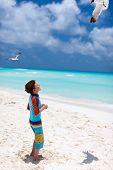 stock photo of flock seagulls  - Little boy and a flock of seagulls at Caribbean beach - JPG