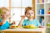 Постер, плакат: children eating in kindergarten