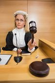 pic of court room  - Stern judge banging her hammer in the court room - JPG