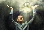 picture of exaltation  - Businessman praying at dollar sign above - JPG