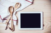 foto of kitchen utensils  - Tablet towel and cooking utensils on wooden kitchen table a blank screen - JPG