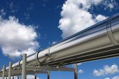 stock photo of transmission lines  - Oil pipelines isolated on blue sky - JPG
